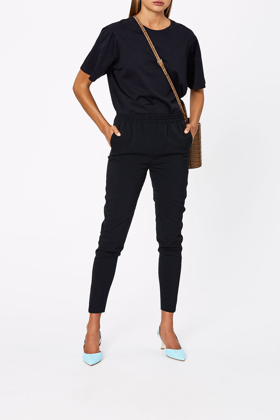 The Crepe Trim Trouser is a slim fit trouser' in a cropped style, featuring a pull on style