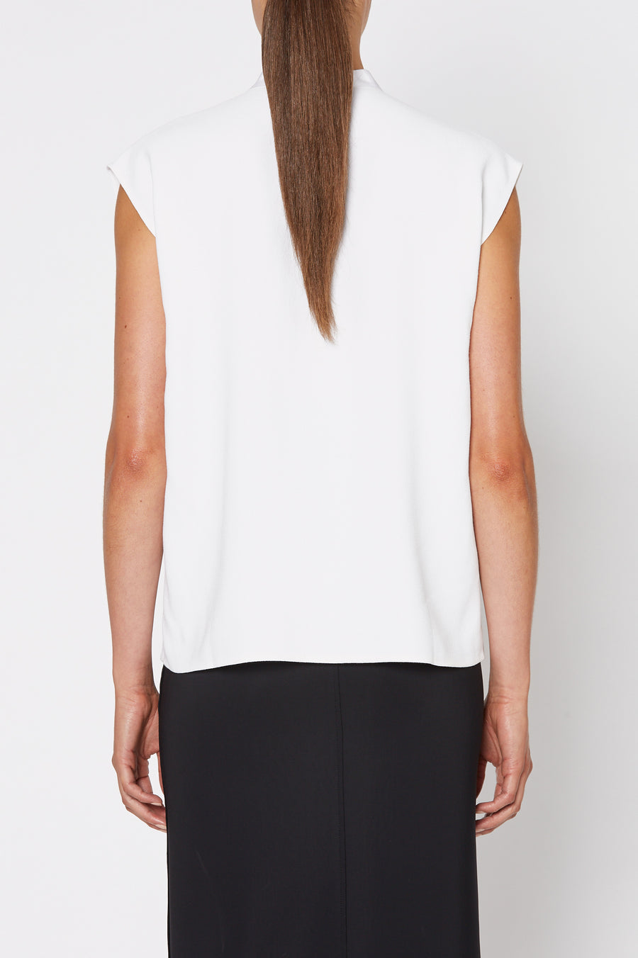 Crepe Tie Neck Tank is made from an Italian plant based fabric, tie neck, short sleeve, color white