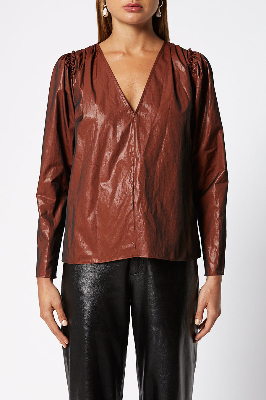 Glossy Blouse is long sleeve with a low V-neckline, color bronze