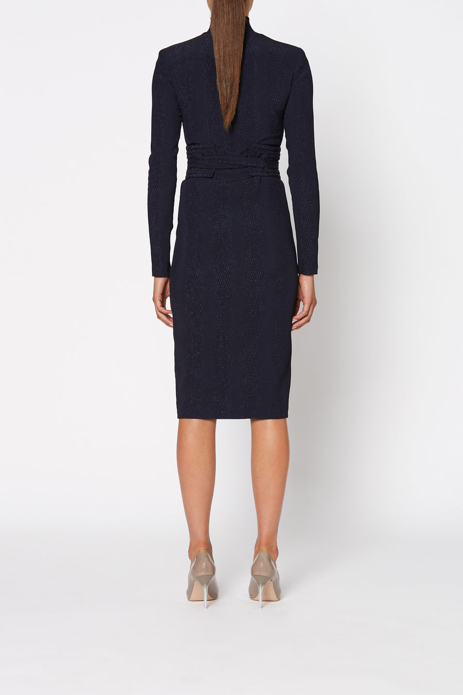 Stretch Reptile Pencil Dress, fitted stretch dress, falls below knee, high neckline, long sleeves, shoulder pads and a wrap around the waist belt. Belt included, Color Navy