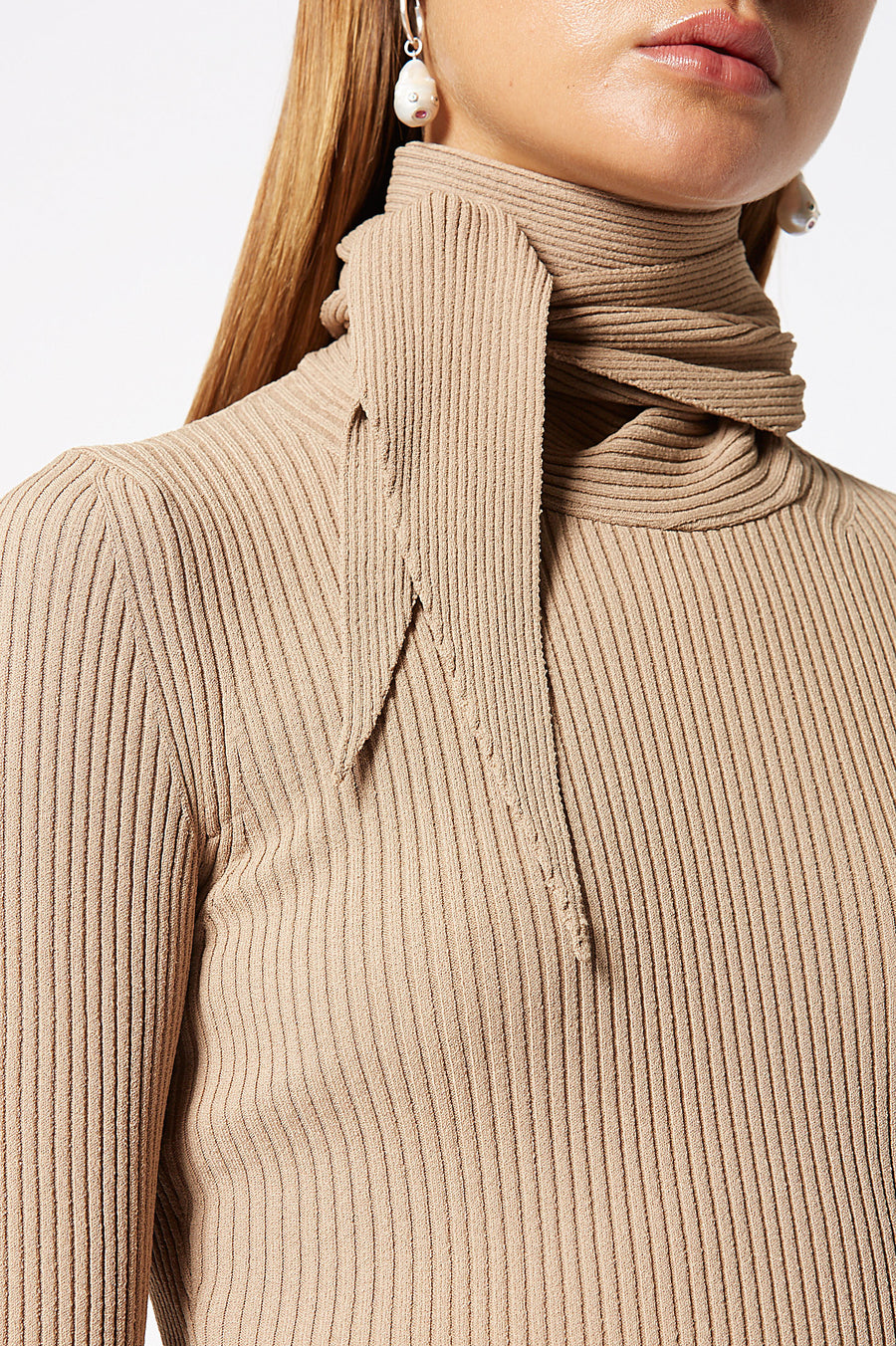 Crepe Knit Cravat Sweater, rib knit construction, high neck and built in cravat ,designed to be tied around the neck, fabric from Italy, color Camel