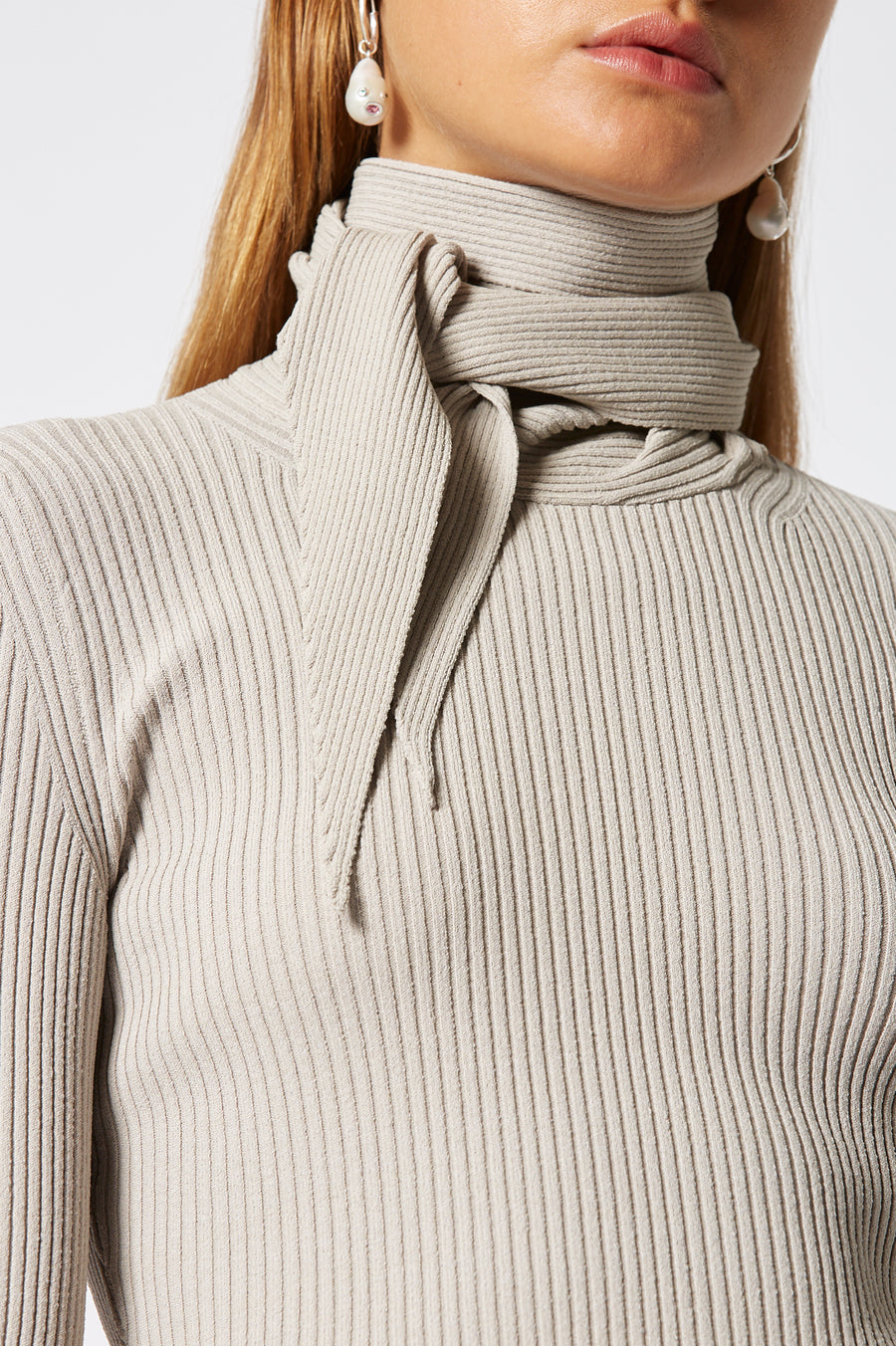 Crepe Knit Cravat Sweater, rib knit construction, high neck and built in cravat ,designed to be tied around the neck, fabric from Italy, color Oyster