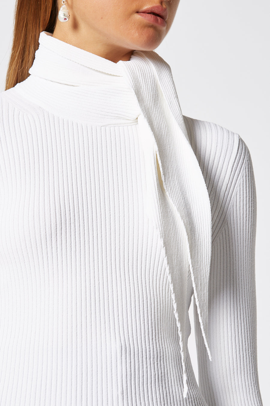Crepe Knit Cravat Sweater, rib knit construction, high neck and built in cravat ,designed to be tied around the neck, fabric from italy, color white