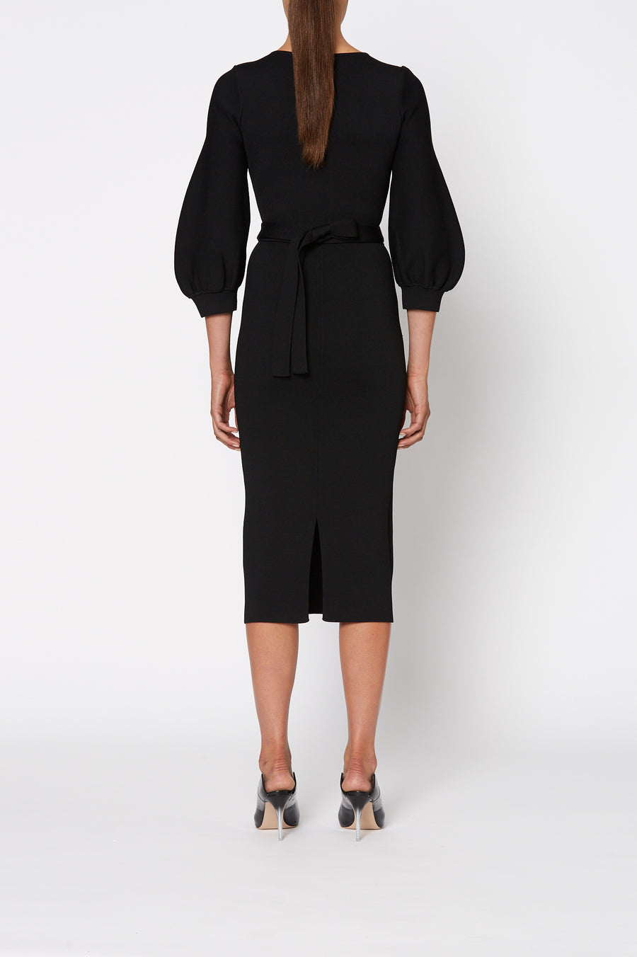 Crepe Knit Cocoon Sleeve Dress, tailored V neck, cocoon sleeves, waist belt and pencil skirt to below the knee. Separate belt in same fabric is inc. Color Black