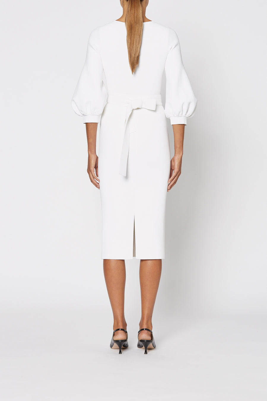 Crepe Knit Cocoon Sleeve Dress, tailored V neck, cocoon sleeves, waist belt and pencil skirt to below the knee. Separate belt in same fabric is inc. Color White