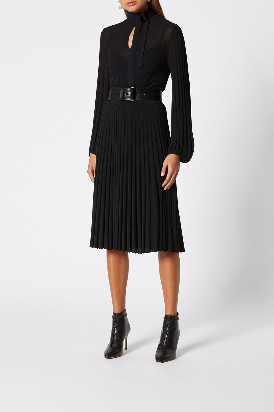 Pleated Rib Tie Neck Dress, knitted in an Italian Viscose/ Polyester blend, natural pleat, tie neck, peplum cuffs, cinches in at the waist, Color Black