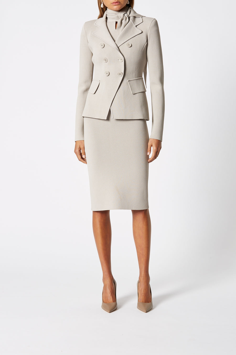 Crepe Knit Tailored Jacket, double breasted lapels, side pockets and a slightly nipped-in waist. Color Oyster