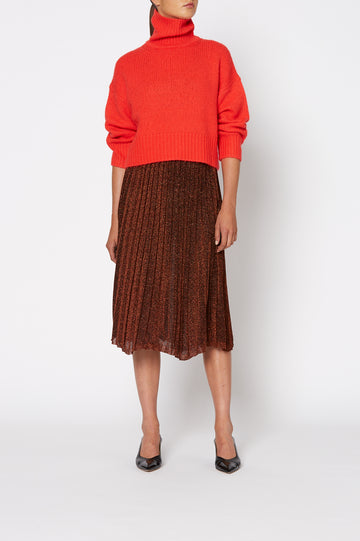 Tinsel Pleat Skirt, voluminous pleats, falls just below the knee, elastic waistband sits high on waist, color Red