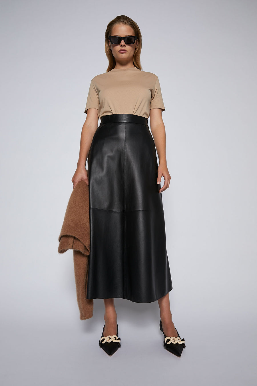 Reinvent your winter staples and invest in the leather long skirt.