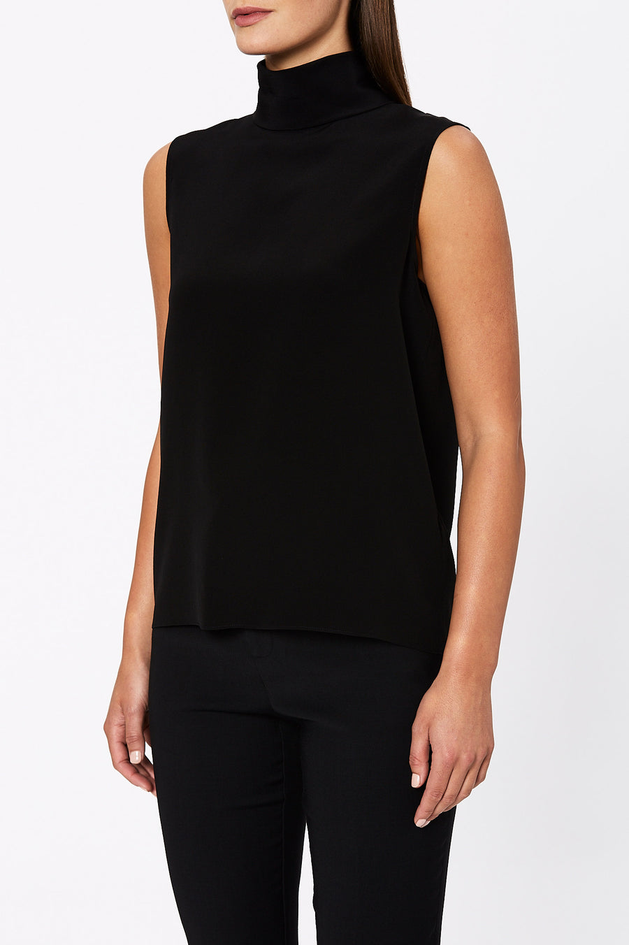 Invest in timeless quality pieces by introducing the Silk Roll Neck tank to your winter wardrobe