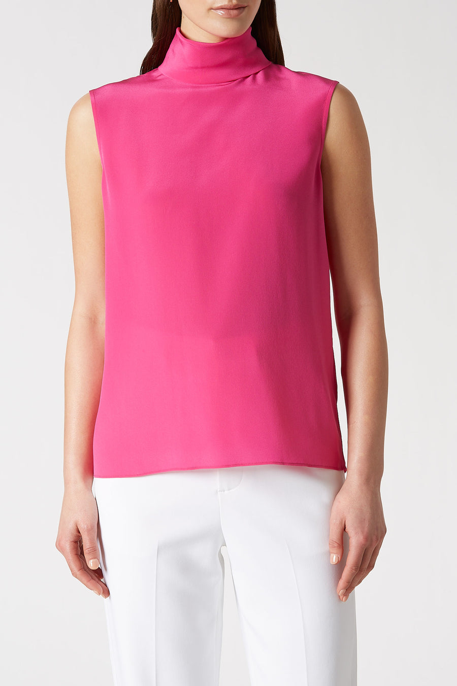 This luxurious silk silhouette is crafted with a soft high neck with a relaxed fit through the body.