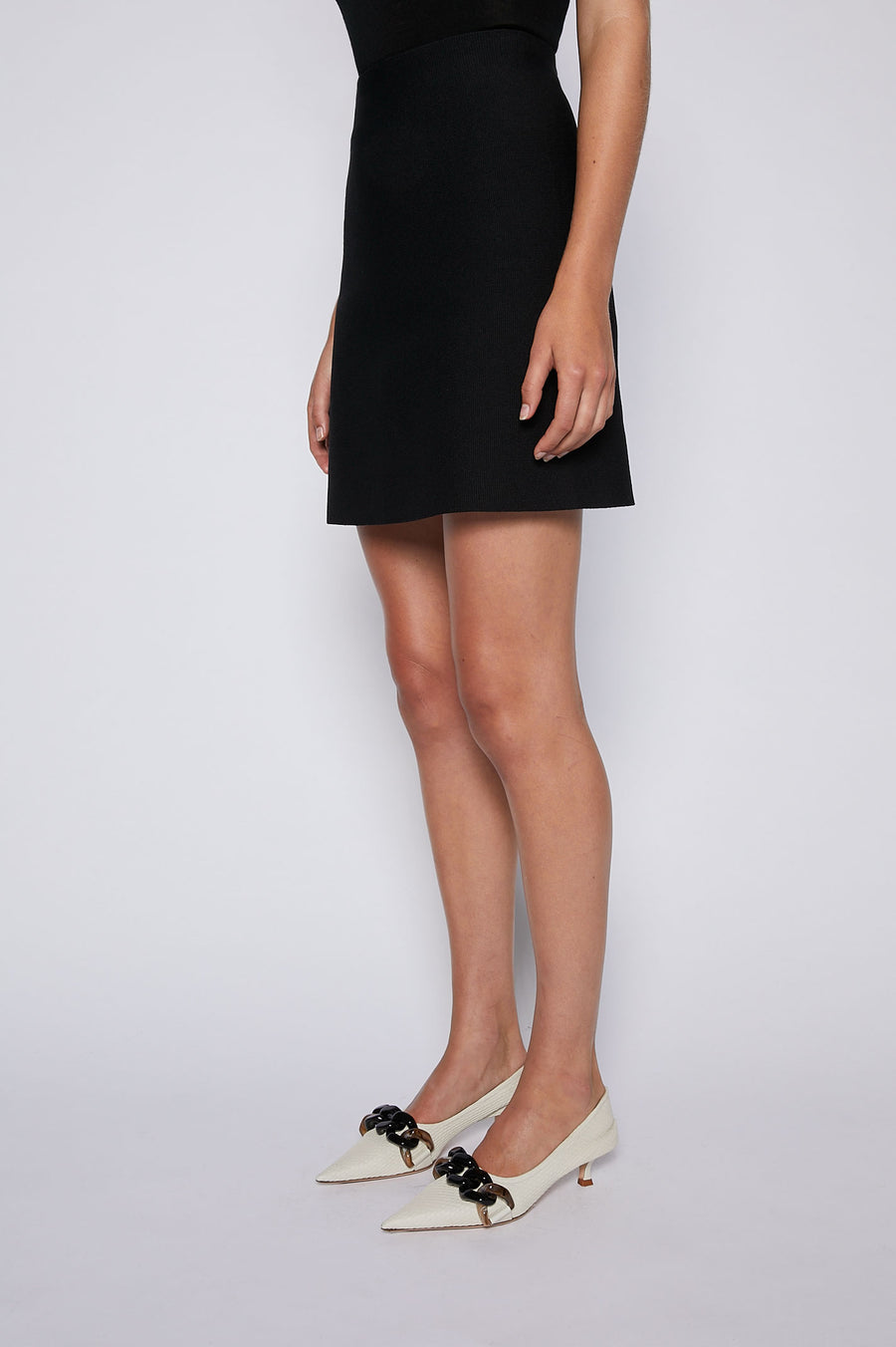 The Crepe Knit Mini Skirt is your transitional wardrobe staple