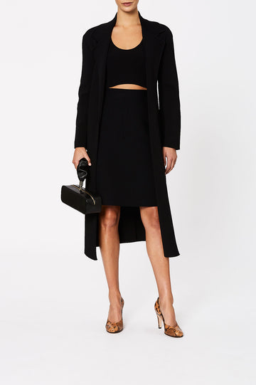 the skirt features an elastic waistband and sits above the knee