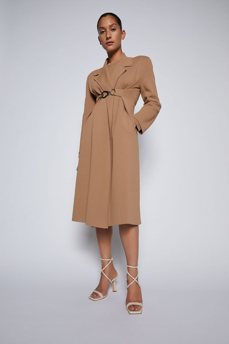 The Crepe Knit Belted Coat combines the elegant structure of our crepe knit fabrication with a soft front drape closure