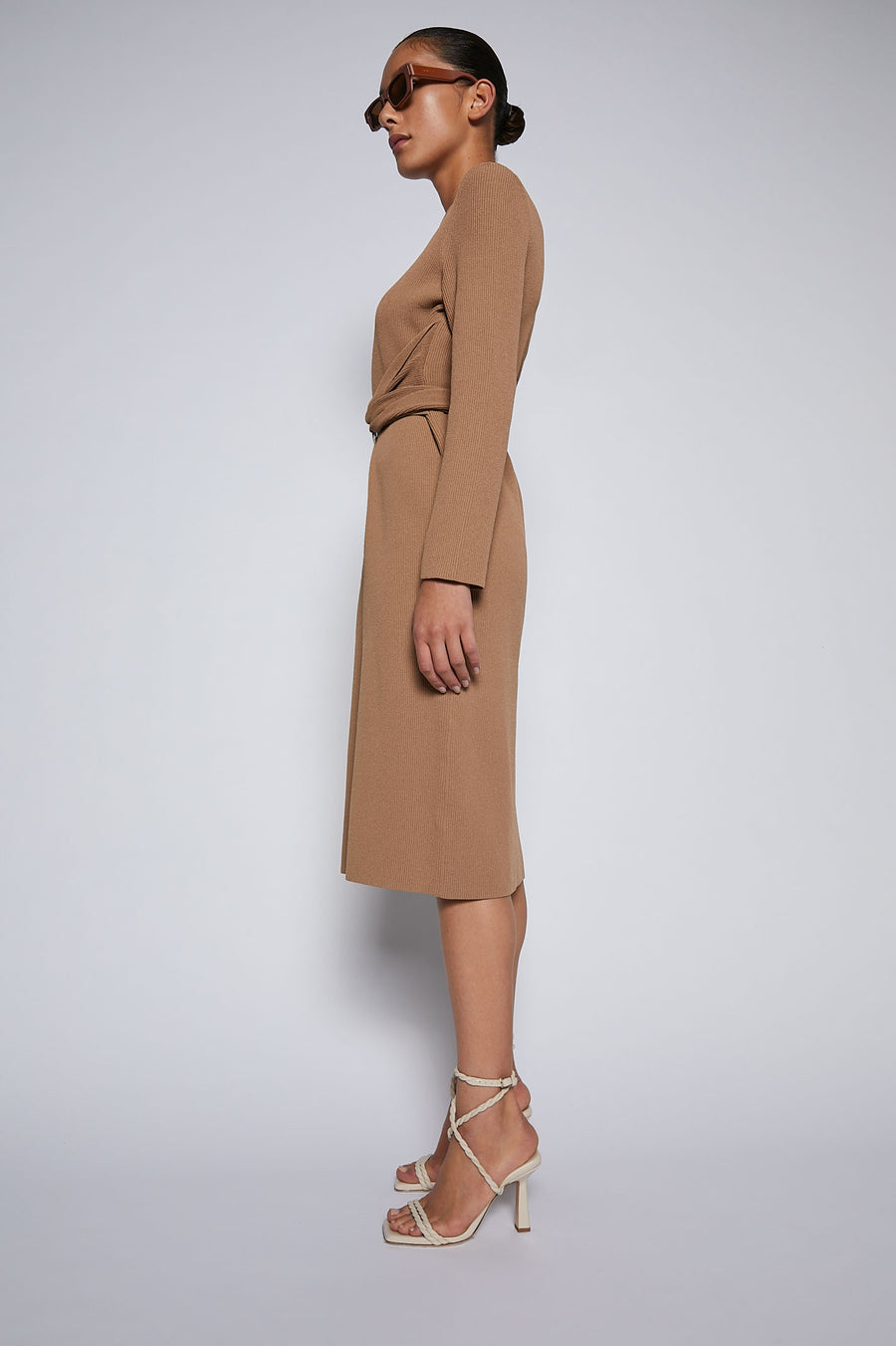 The Crepe Knit Belted Dress features long sleeves, below the knee length, reversible belt and silver hardware.