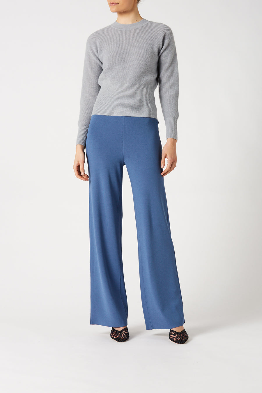 Featuring high waist with thin elasticated waistband and wide leg, the High Waist Knit Trouser exudes chic transitional styling.