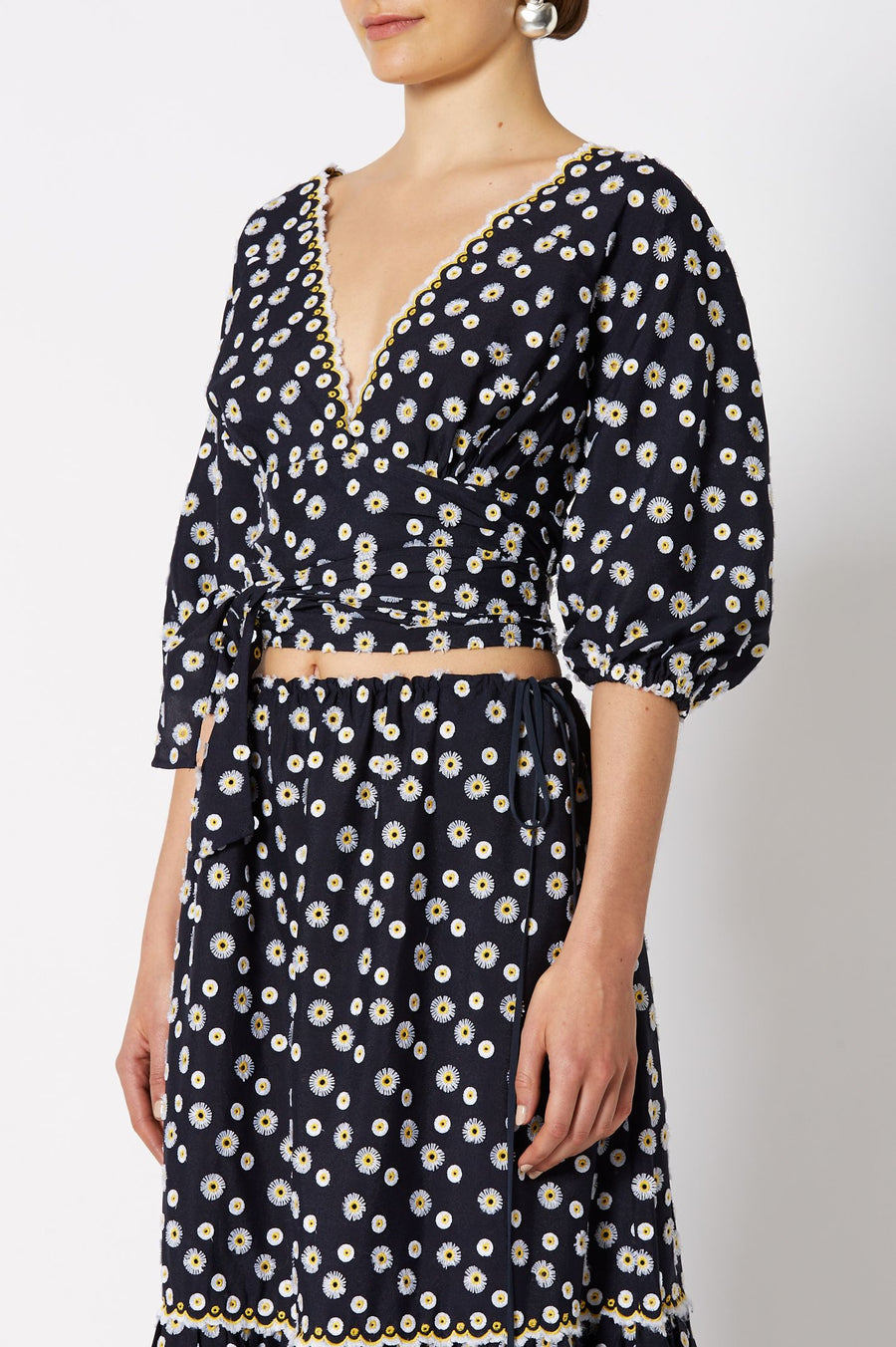 EMBROIDERED DAISY TOP NAVY,Deep v-neckline, Waist tie