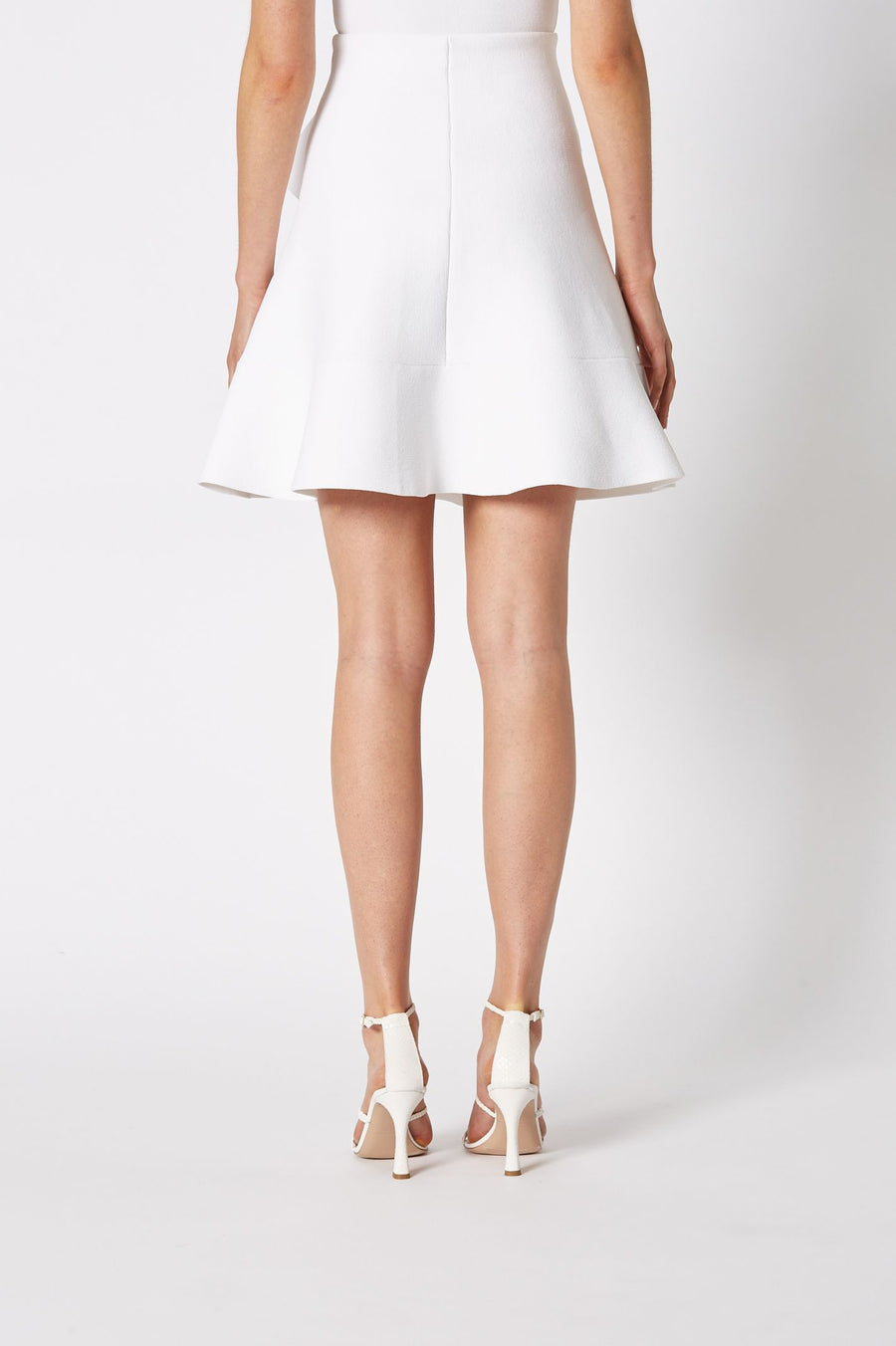 CREPE KNIT RUFFLE SKIRT, FALLS JUST ABOVE KNEE, A-LINE STYLE WITH ONE SIDE RUFFLE, COLOR WHITE