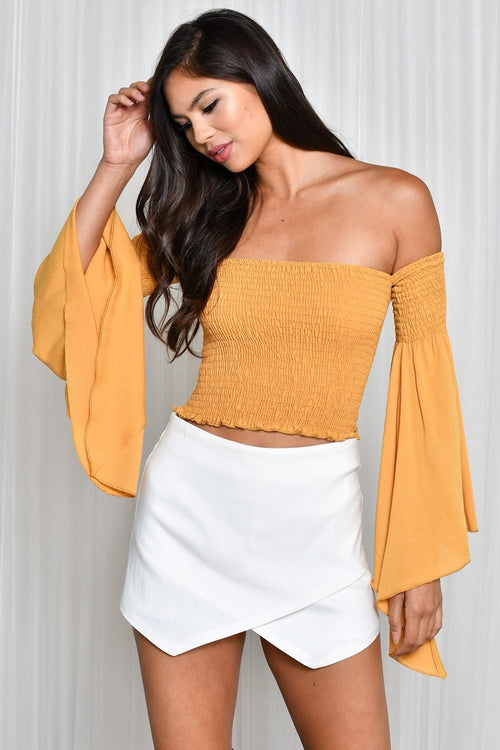Buy Off Shoulder Smocking Crop Top online by Fit Miami Style for $36.99