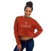 Woman wearing cropped crewneck sweatshirt in brick
