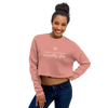 Woman wearing cropped crewneck sweatshirt in pink