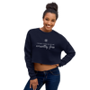 Woman wearing cropped crewneck sweatshirt in navy