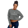 Woman wearing cropped crewneck sweatshirt in gray
