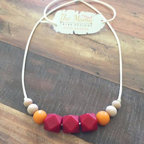 The Mama Tribe Designs Teething necklace nursing necklace for mom with red, orange, wood, chewable, food-grade silicone beads, breastfeeding, new mom gift, baby shower gift, teething baby
