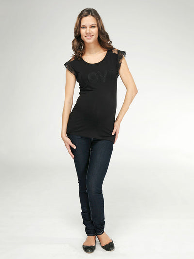 Maternity Top with Lace Accents Paired with Skinny Maternity Jeans