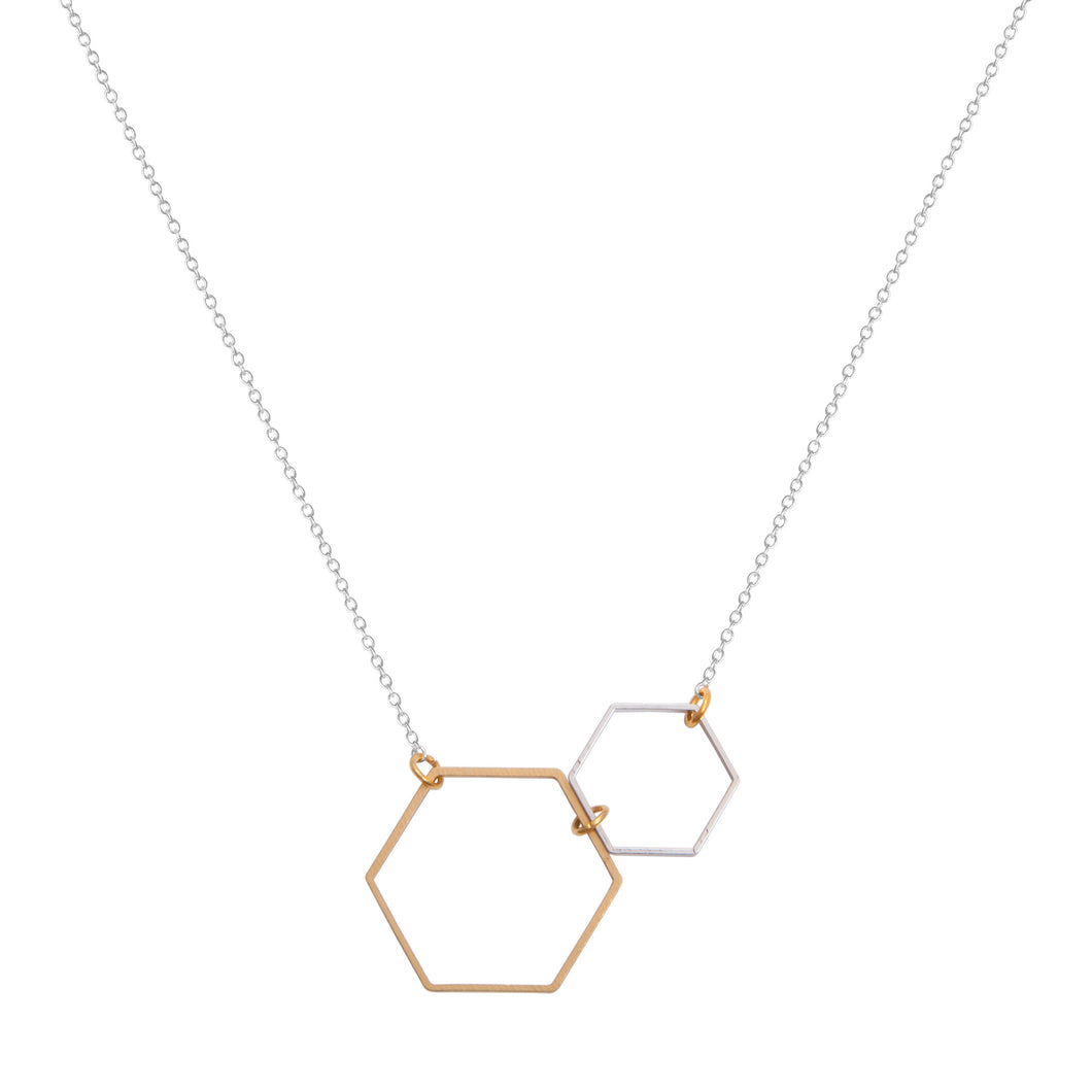 a weathered penny brass and silver double hexagon necklace