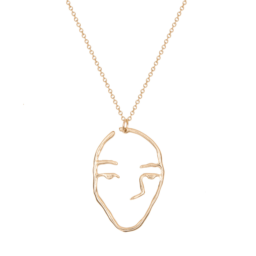 a weathered penny gold line drawing face necklace long