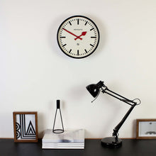 newgate luggage black and white red hands wall clock in situ