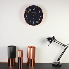 newgate master edwards navy and copper wall clock in situ