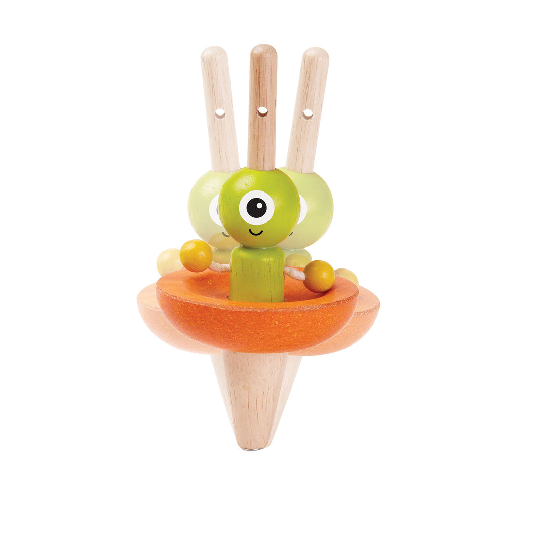spinning alien wooden toy