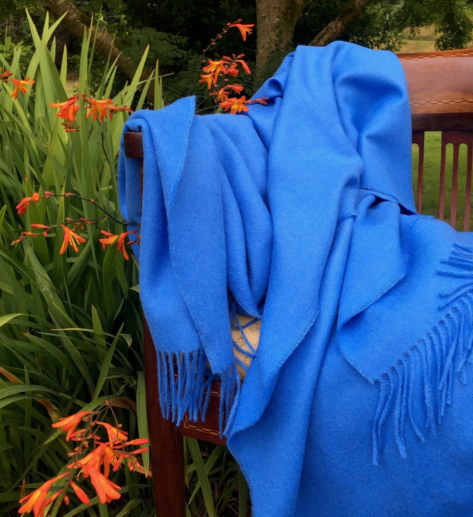 cobalt blue throw in a garden