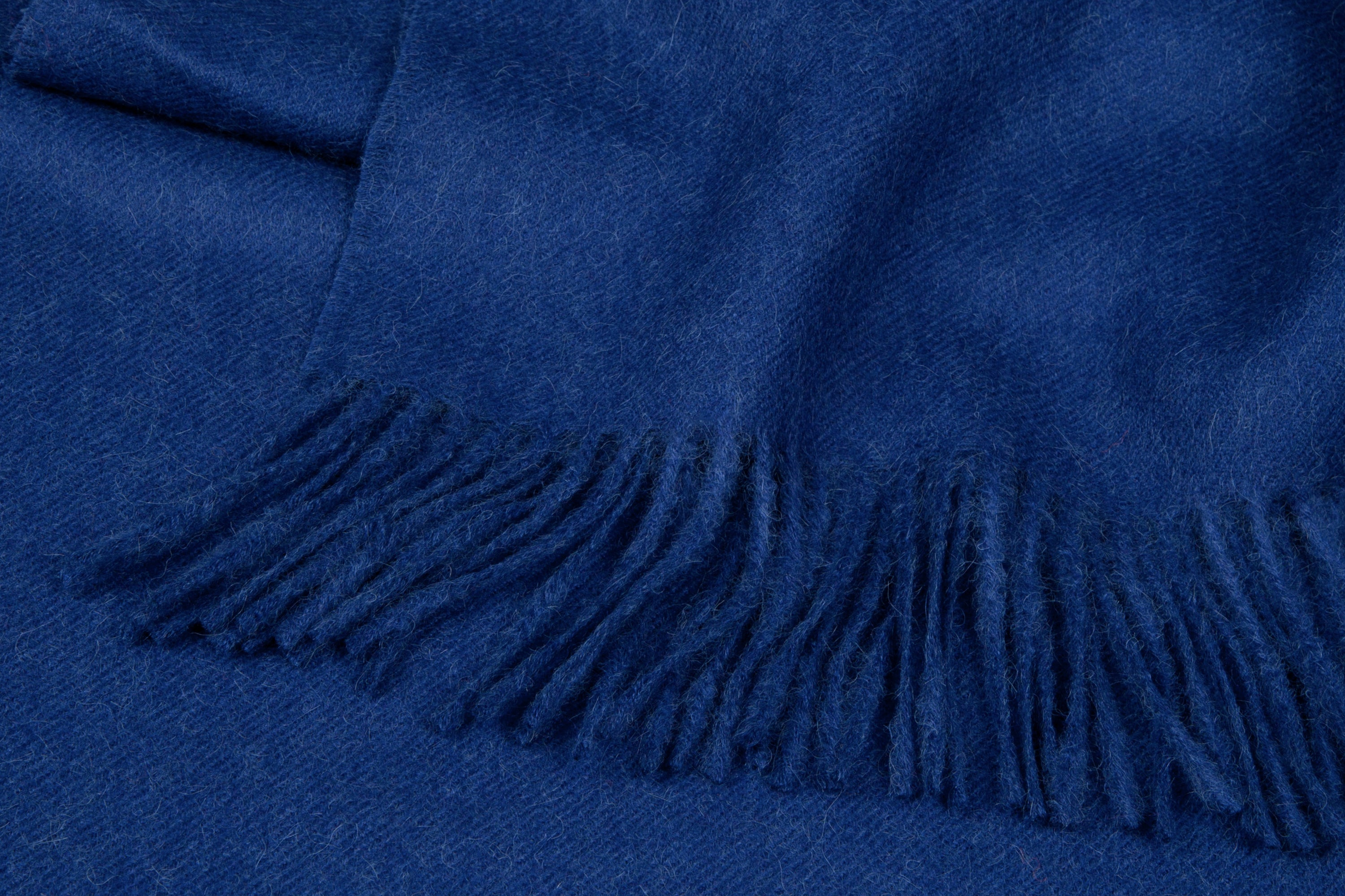 Detail dark blue Alpaca throw with fringe