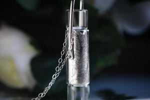 Double silver feather rollerball necklace