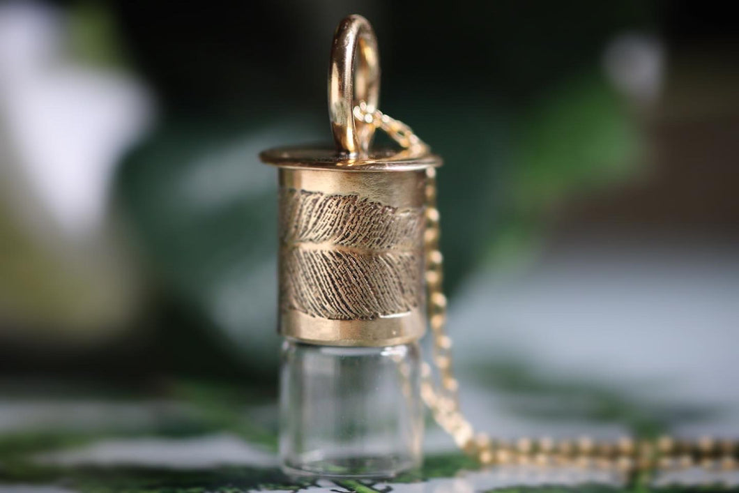 Simple everyday brass feather rollerball necklace
