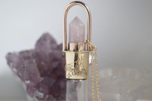 Brass and bronze cosmic moth kunzite rollerball necklace