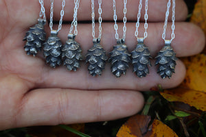 Mini solid sterling silver hemlock cone necklace