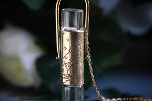 Double brass scenic wolf rollerball necklace