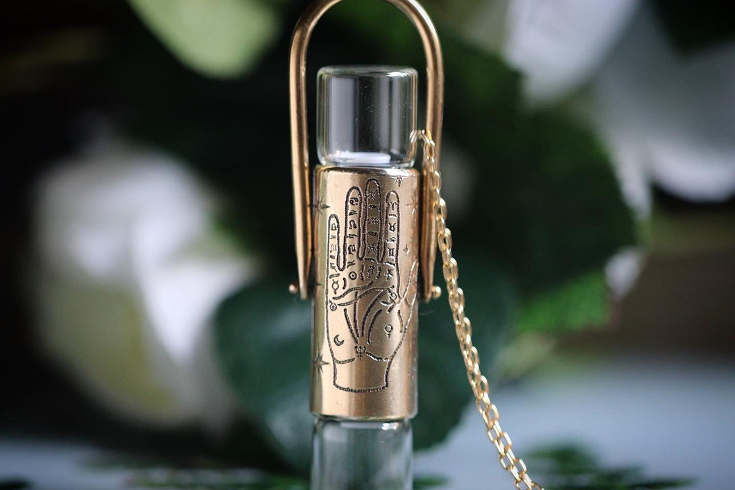 Double brass palmistry hand rollerball necklace