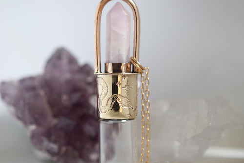 Brass and bronze cosmic snake kunzite rollerball necklace