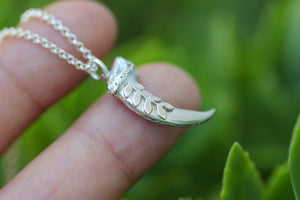 Leafy vine coyote claw necklace
