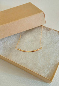 Girls gold tube necklace