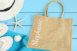 Burlap Wedding Welcome Bag personalized with vertical name in white