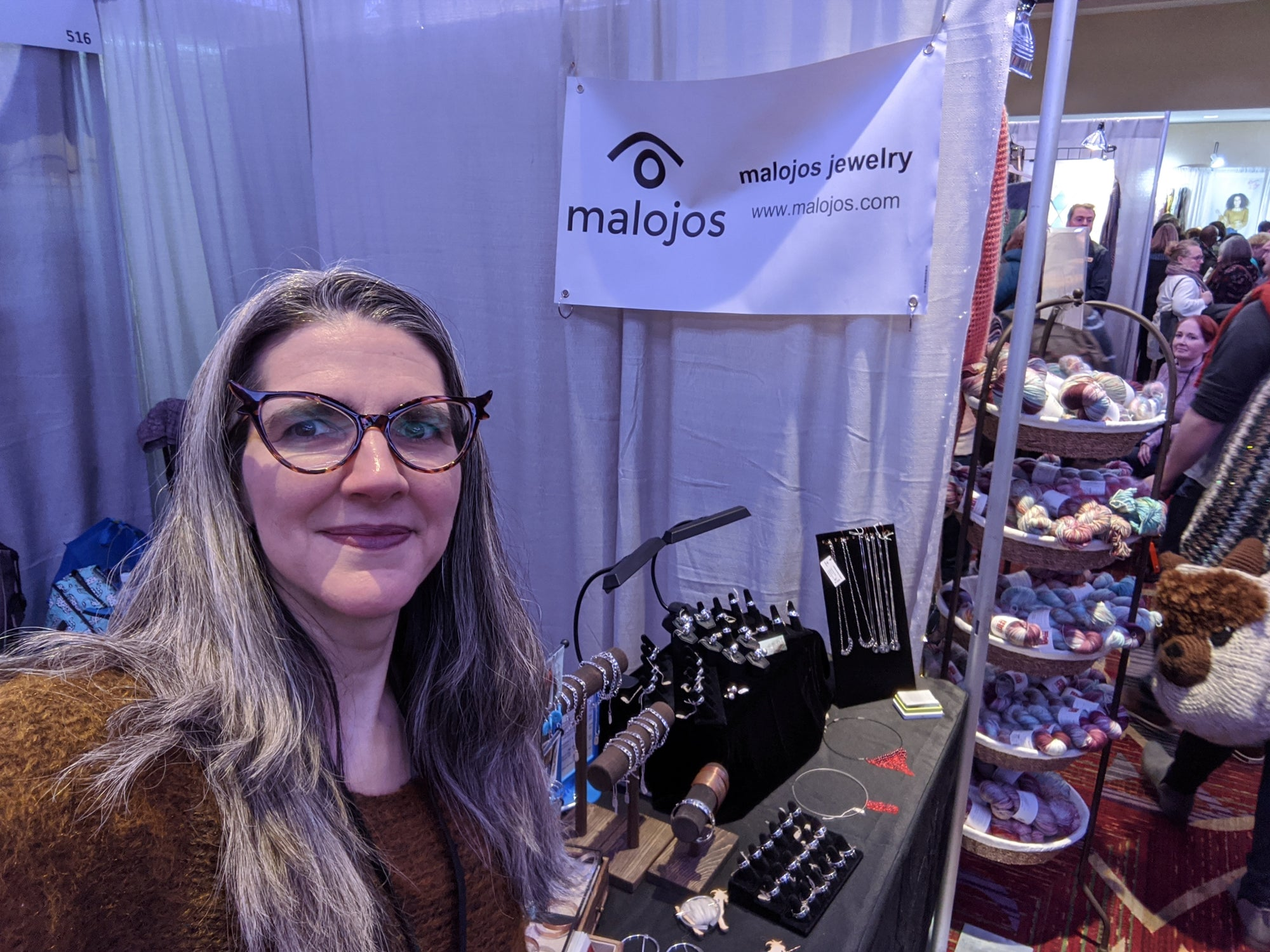 Natalia next to her Malojos booth at Vogue Knitting Live NYC