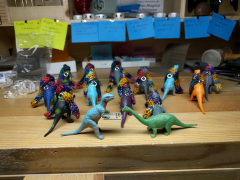 dinosaurs getting ready for Vogue