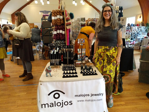 Natalia standing in front of her booth at the Rhinebeck Yarn Bazaar
