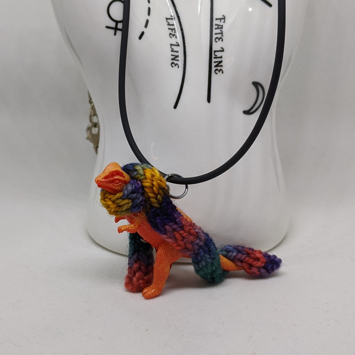 "Dinosaur in Scarf Necklace, 18"" Rubber Cord"
